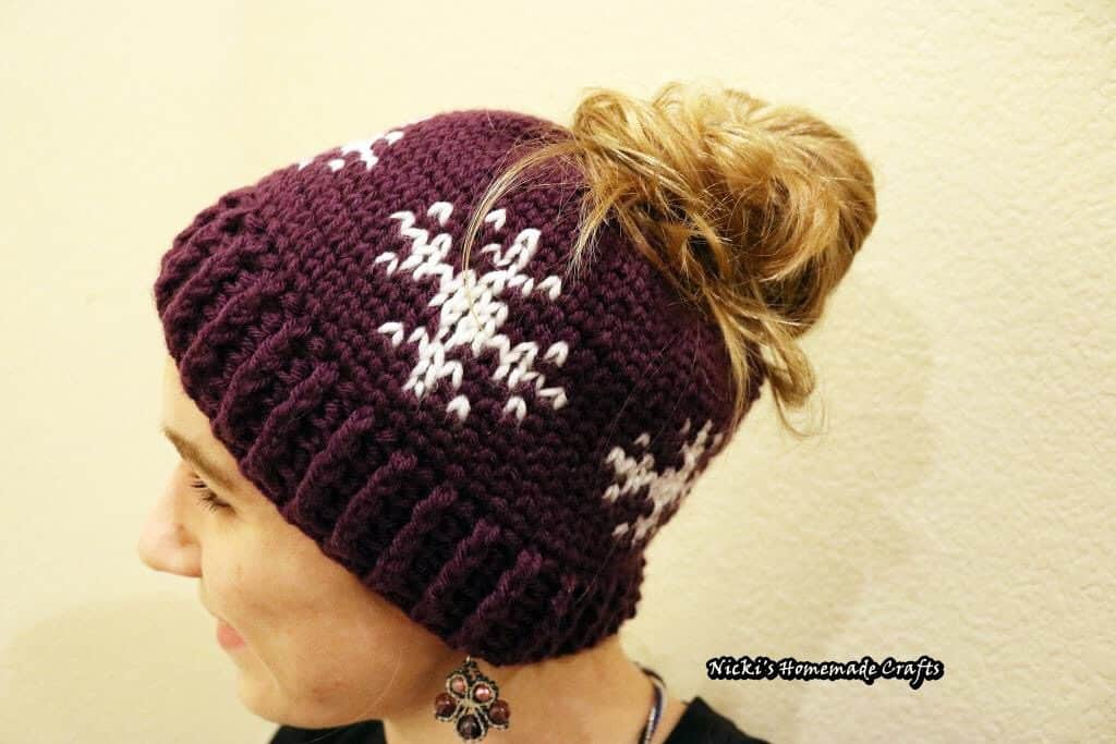 Snowflakes Messy Bun Hat - Free Crochet Pattern by Nicki's Homemade Crafts #crochet #waistcoat #freecrochetpattern #hat #messybun