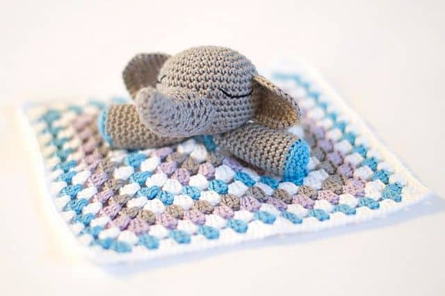 Crocheted, Blue, Pink, White Blanket with a grey elephant