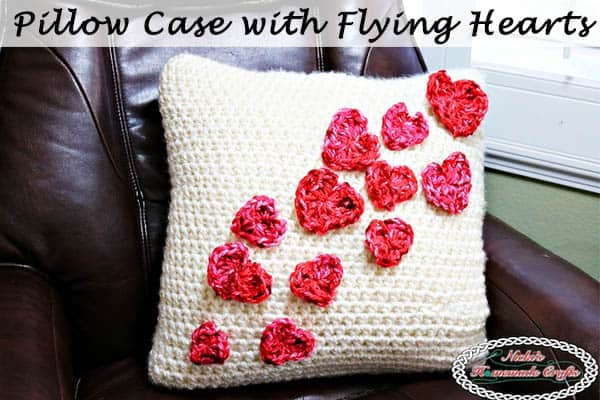 Flying Hearts made without Sewing or Slip Stitches - Free Crochet Pattern by Nicki's Homemade Crafts #crochet #pillow #case #flying #hearts #without #sewing #slipstitches #Valentinesday #love #cozy #comfy #easy #video #tutorial