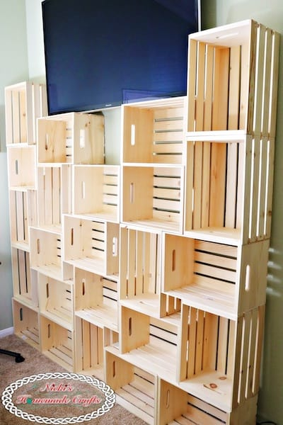 Wooden Crates make a storage shelving unit for yarn and books