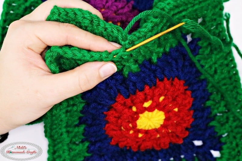 close up of sewing technique for crochet flower blanket