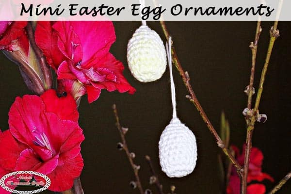 Mini Easter Egg Ornaments on Easter Branches with red flowers as a free crochet pattern