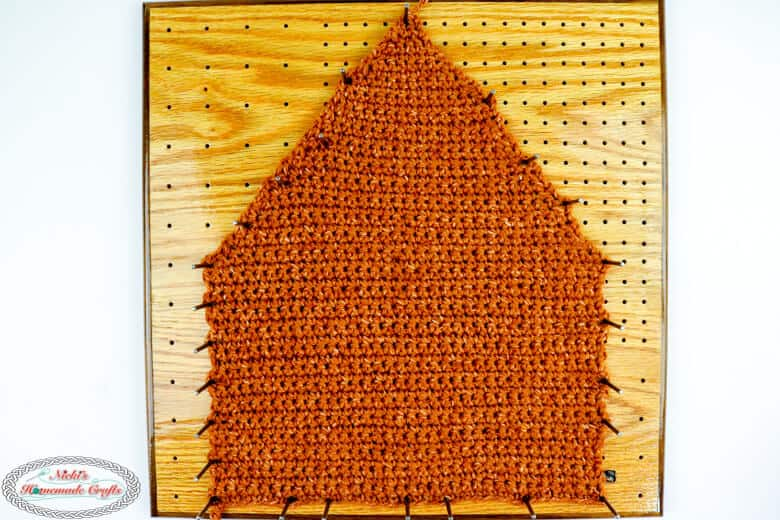Back side of the crocheted Gingerbread House blocked