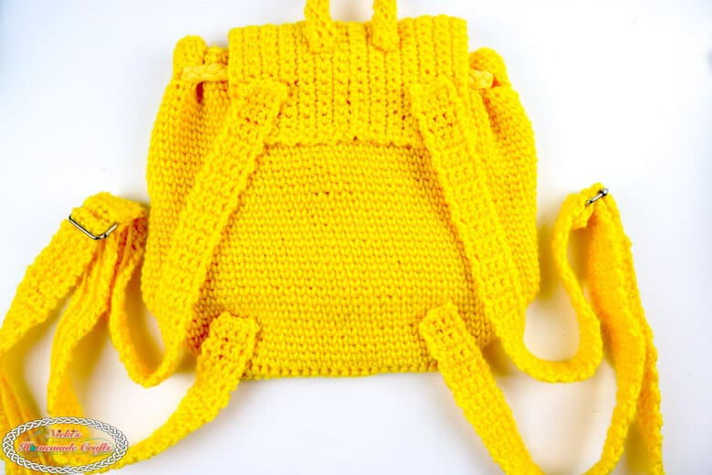 back of the crochet yellow little backpack with shoulder straps