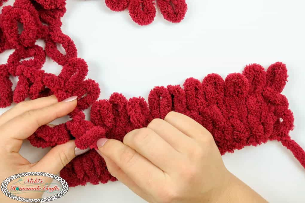 with hands knitted with loop yarn