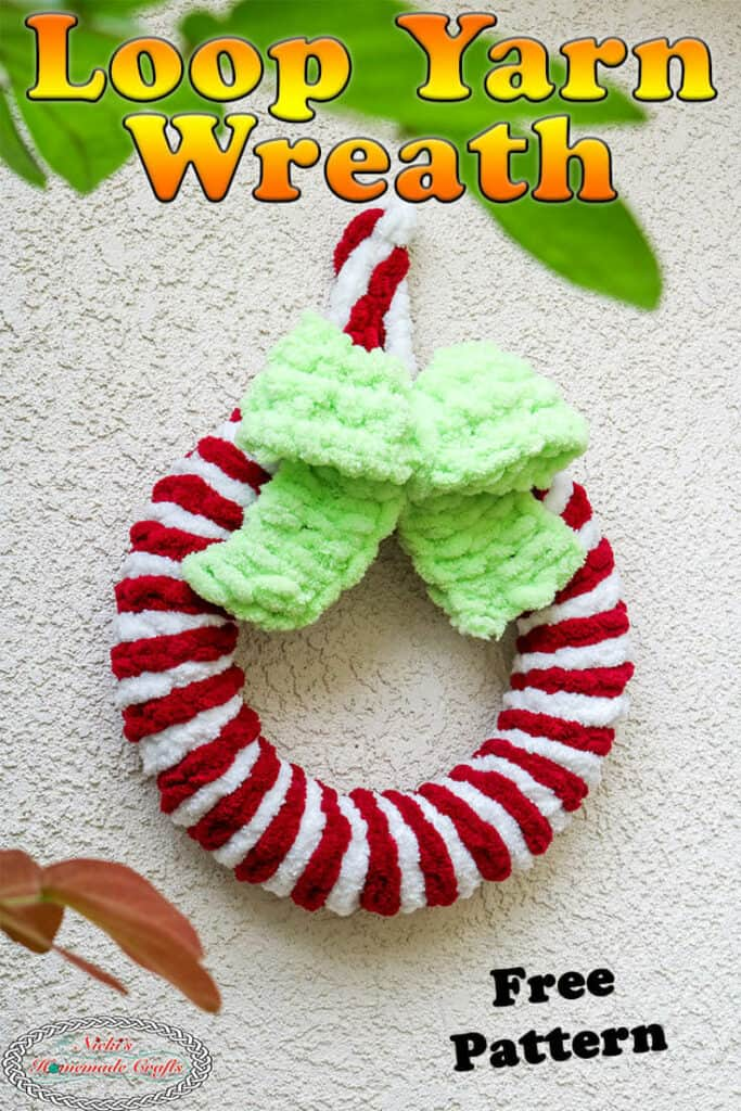red and white loop yarn wreath with grinch green bow