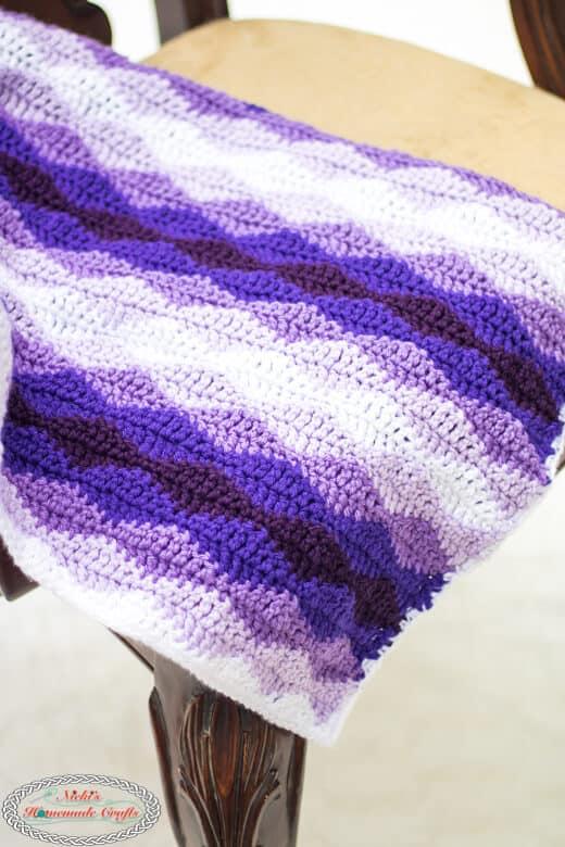 Rolling Waves Crochet Blanket - Free Crochet Pattern on Chair