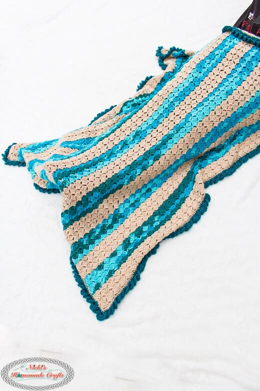 Beach throw blanket on a lap