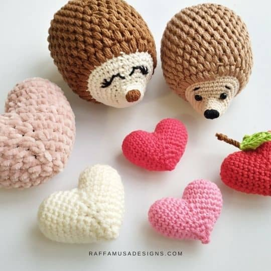 a couple of hedgehogs with hearts