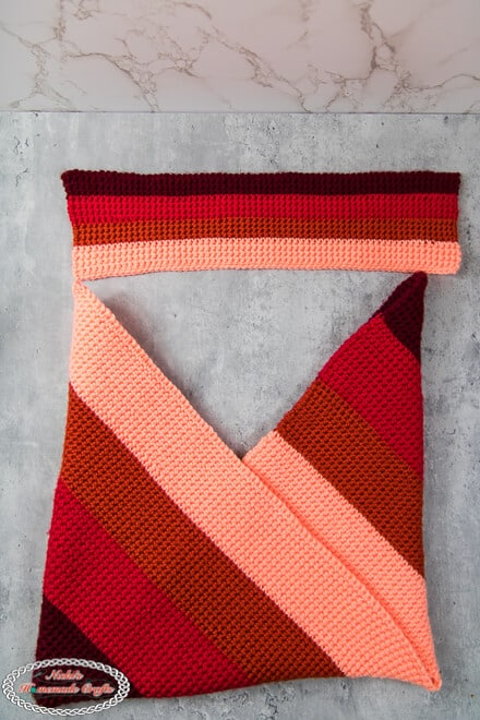 folded thermal stitch origami bag folded with strap