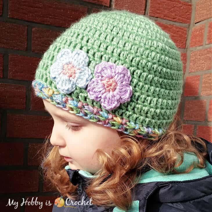 cute crochet hat with a flower appliqué