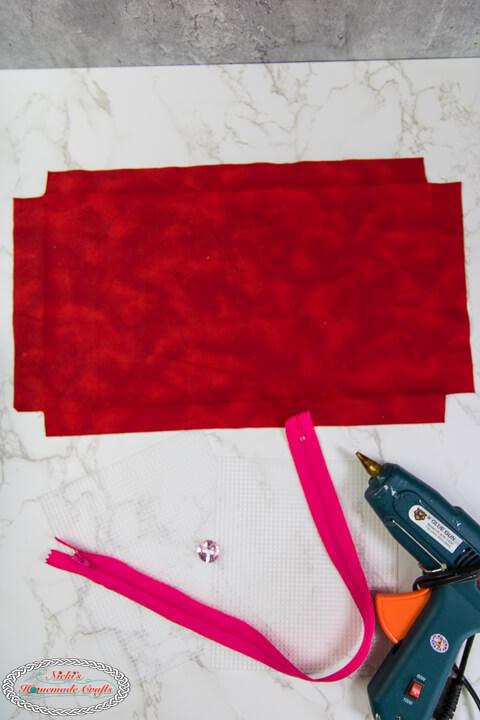 Materials needed to make a Crochet Hook Holder - Plastic Canvas, Zipper, Button, Fabric and Glue Gun