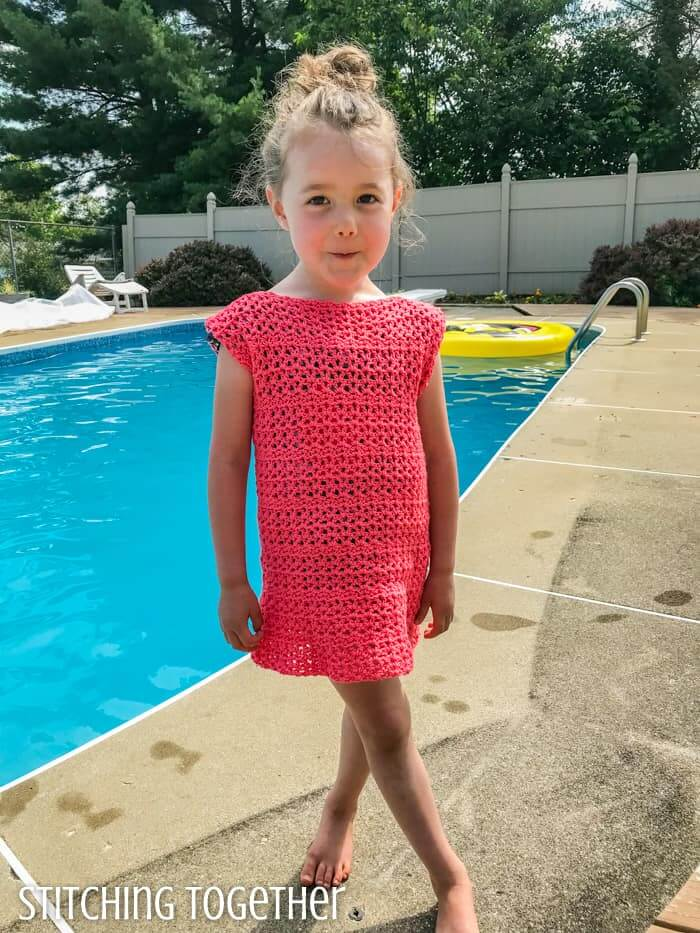Adelaide Girls' Dress Pattern in pink worn by a girl at a pool