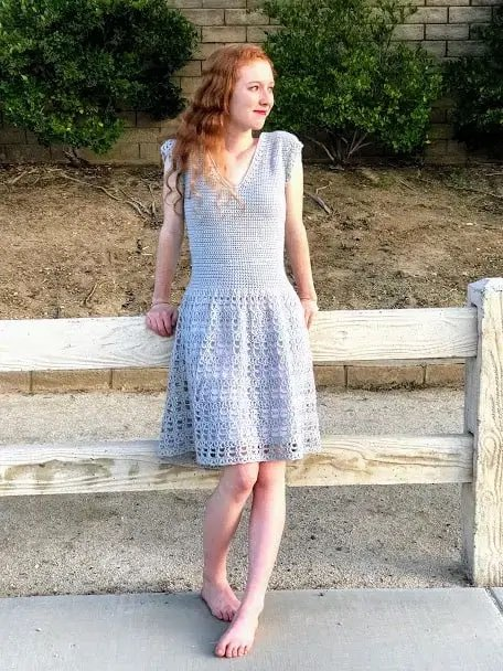 Parisian Crochet Dress Pattern worn by a woman with ginger hair